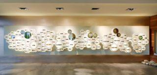 Vi-arise Unternehmenskonzept für Kraft Augenoptik Stuttgart - Laden Brillenwand